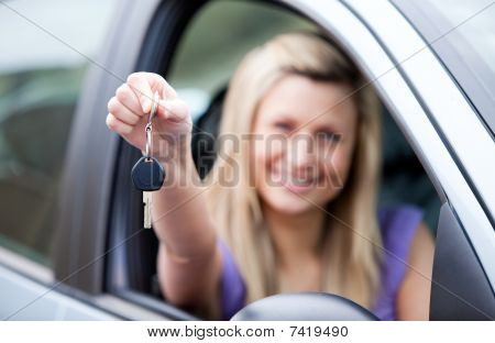 Young Female Driver Holding A Key