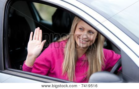 Cheerful Female Driver At The Wheel