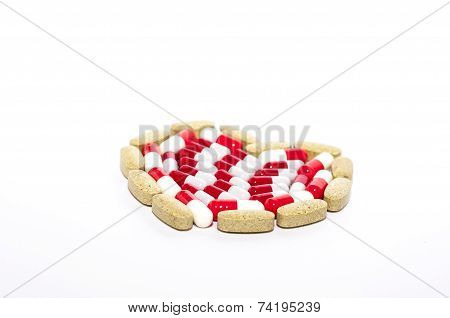 colorful tablets arranged in heart shape