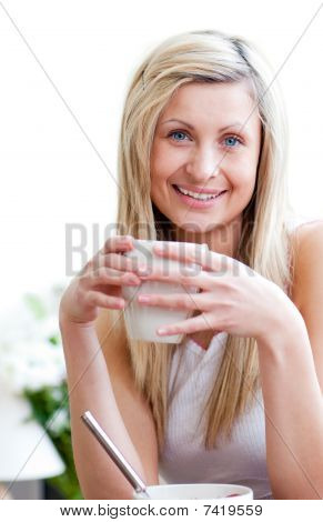 Portrait Of A Smiling Young Woman Drinking A Coffe