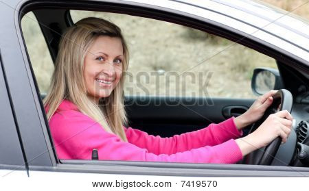 Smiling Female Driver At The Wheel