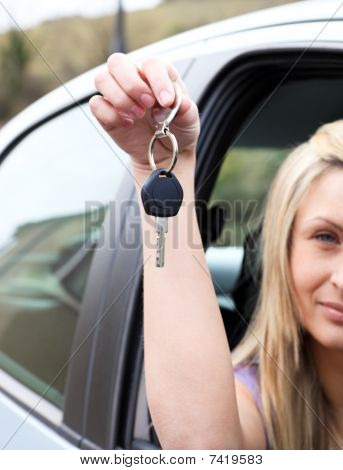 A Driver Holding A Key After Bying A New Car