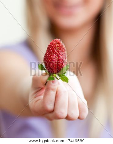 Close-up Of A Woman Showing A Strawberry
