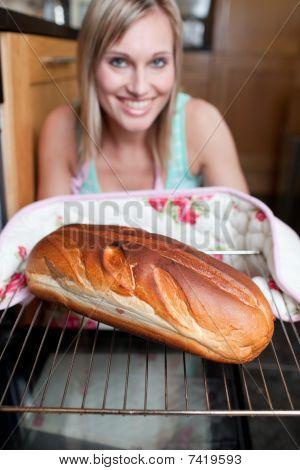 Happy Woman Baking Bread