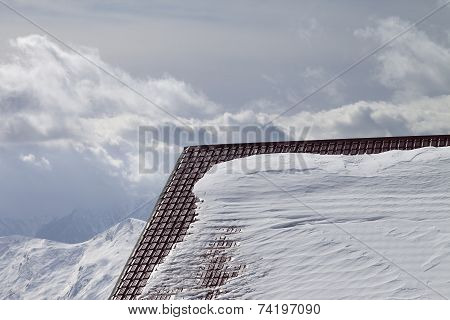 Roof Of Hotel In Snow And Winter Mountains