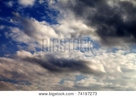 Blue Sky With Sunlight And Dark Clouds