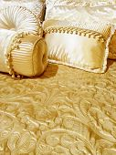 picture of pillowcase  - Bed with luxurious silky bedding and decorative cushions - JPG