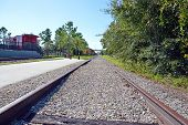 picture of caboose  - This is a photo of train tracks leading to the passenger depot - JPG