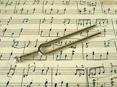 pic of tuning fork  - Fork on old sheet music - JPG