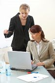 stock photo of human resource management  - two businesswoman are discussing the work - JPG