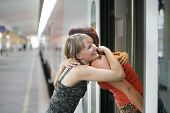 foto of say goodbye  - two sisters saying goodbye at the railway station  - JPG