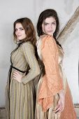 stock photo of wench  - two brunette young girls dressed as princess - JPG