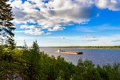 picture of barge  - Old barge floating up the river Northern Dvina - JPG