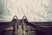 stock photo of typewriter  - Vintage typewriter and crumpled paper - JPG