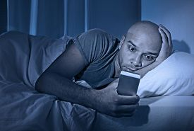 pic of chat  - young cell phone addict man awake at night in bed using smartphone for chatting flirting and sending text message in internet addiction and mobile abuse concept - JPG