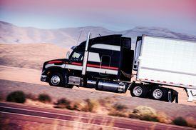 image of trucks  - Semi Truck on the Highway - JPG