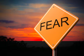 foto of shock awe  - Fear on Warning Road Sign on Sunset Sky Background - JPG