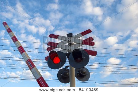 Rail crossing and a cloudy sky