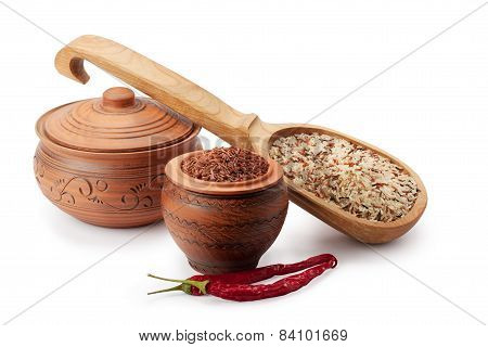 Clay Pots, Wooden Spoon, Wild Rice And Chili Peppers