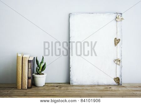 Hipster Scandinavian Style Home Decoration. Old Wooden Poster With Succulent And Books