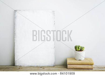 Hipster Scandinavian Style Home Decoration. Old Wooden Poster With Cactus And Books