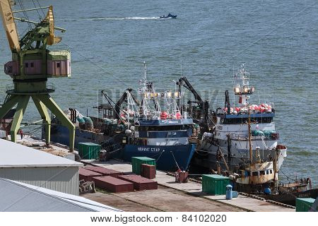 View of Petropavlovsk-Kamchatsky port and ships crabber at the pier