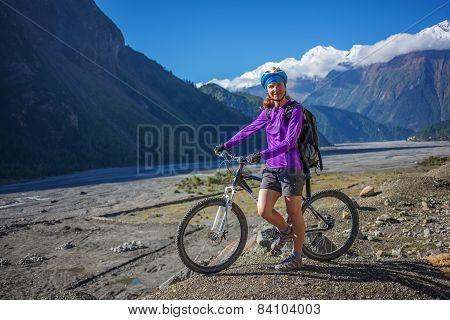 Biker-girl in Himalaya mountains Anapurna region