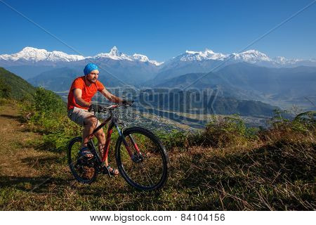 Biker-boy in Himalaya mountains Anapurna region