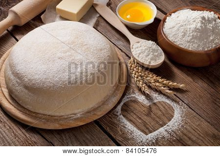 Easter Concept. The Dough Is Made From Flour And Heart On The Table From The Old Boards