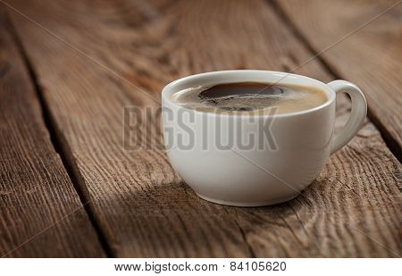 A Cup Of Coffee On The Table Of The Old Boards