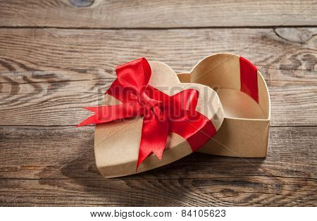 Concept Gift. Box In The Form Of Heart On The Old Boards.