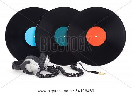 Headphones Next To Vinyl Records