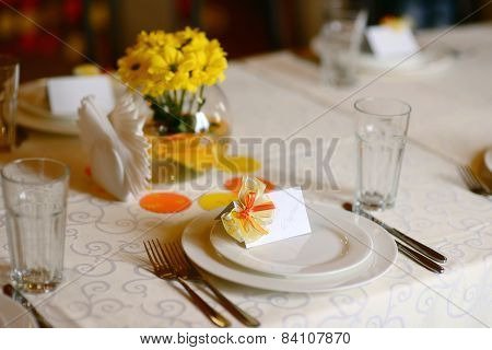 holiday table with yellow flowers