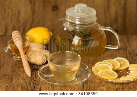 Cup Of Ginger Tea With Honey And Lemon On Wooden Table