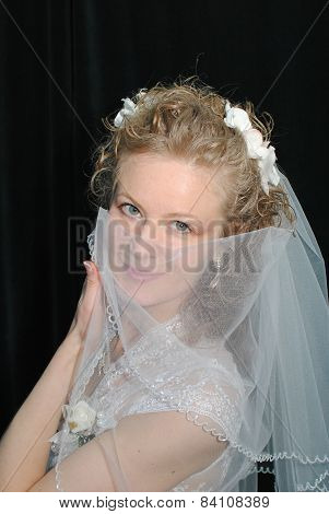 Young blonde bride posing for the camera indoors