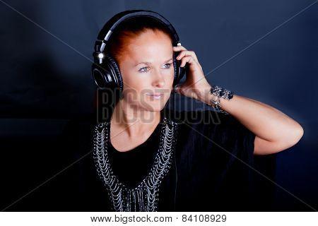 Redhead Woman Listening To Music