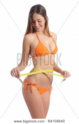 Beautiful Girl Measuring Her Waist With A Tape Measure