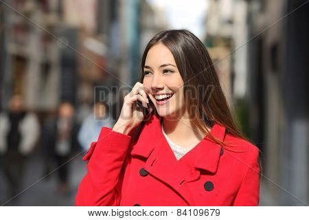 Cheerful Woman Talking On The Phone In The Street