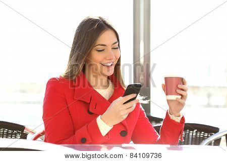 Fashion Woman Using A Smartphone In A Coffee Shop