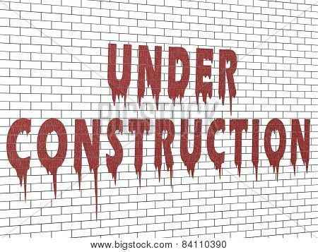 Under Construction - Inscription On A Brick Wall With Oil Paint Streaks