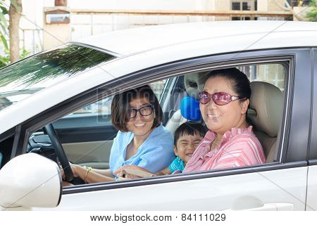 Two Woman And Children Driving Car With Happy Face