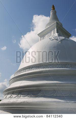 Exterior of the white painted stupa at Isurumuniya rock temple in Anuradhapura, Sri Lanka.
