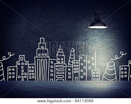 Concrete wall with sketches of buildings. Right standing lampshade