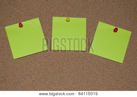 Green Post it Notes on a Cork Board