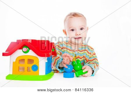 Cute baby play with toy house