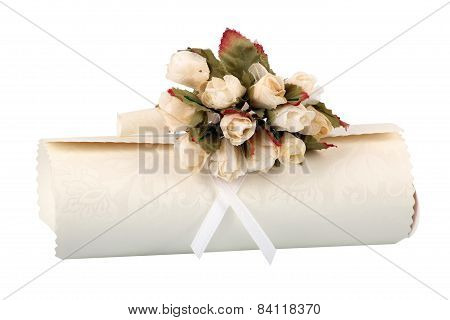 Rolled Parchment With Bunch Of Fake Roses.