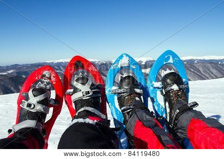 Snowshoeing -  trekking in winter mountains.