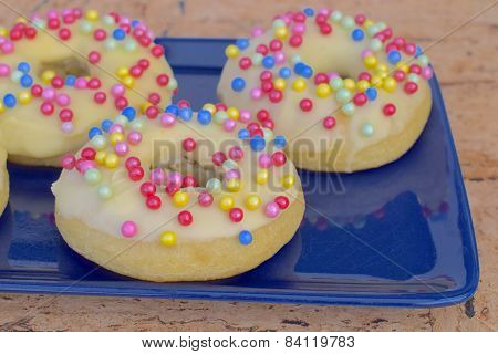 Donuts with colorful sugar sprinkle