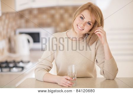 Portrait of young woman in kitchen