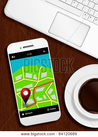 Mobile Phone With Gps Application, Laptop And Coffee Lying Od Desk